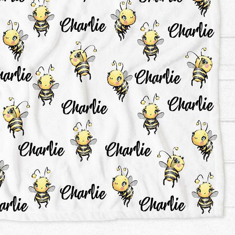Minky fleece pram cot single bed blanket with white background and yellow and black bees personalised with the name Charlie