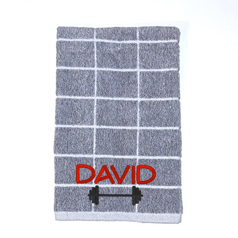 Light grey and white check gym towel or sports towel personalised with a name and dumbbell weight bar