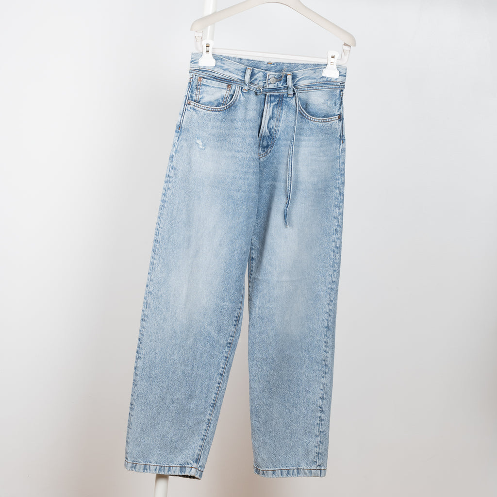 The 1991 Jeans by Acne Studios is a high waisted jeans with an oversized & loose fitted leg and a waist drawstring detail