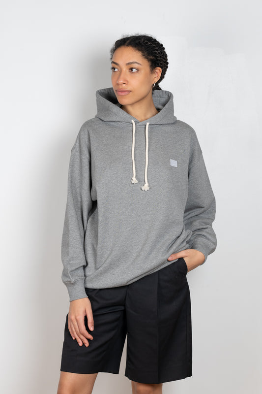 The Hooded Sweatshirt by Acne Studios is a lightweight terry sweatshirt in light grey with a Face Capsule Logo Patch
