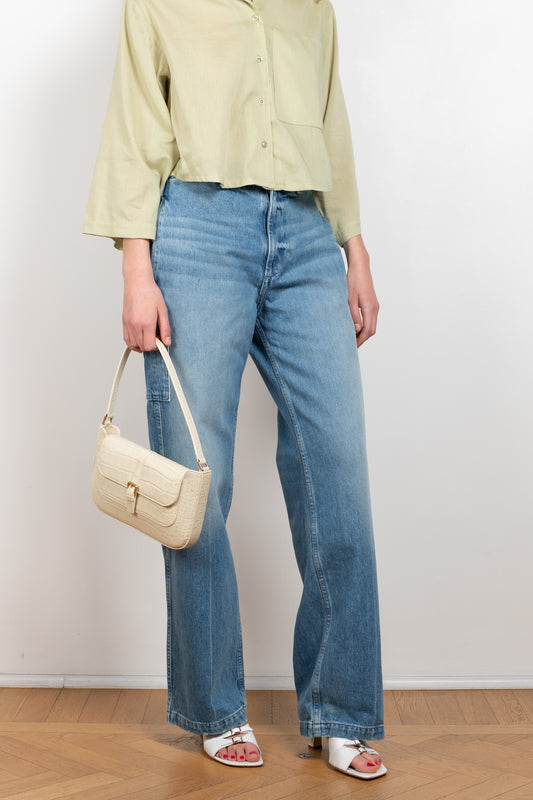 The Cinch Back Jeans by B Sides is a high waisted cargo inspired jeans with a relaxed straight fit in medium blue