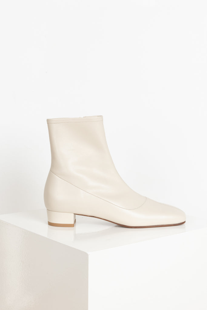 The Este Boots by By Far are 60's inspired boots with a soft rectangular toe, a low heel and a fitted shaft in a soft and supple cream leather
