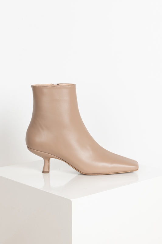 The Lange Boots by By Far are 90's inspired boots with a rectangular toe & everyday heel in a soft and supple nude leather