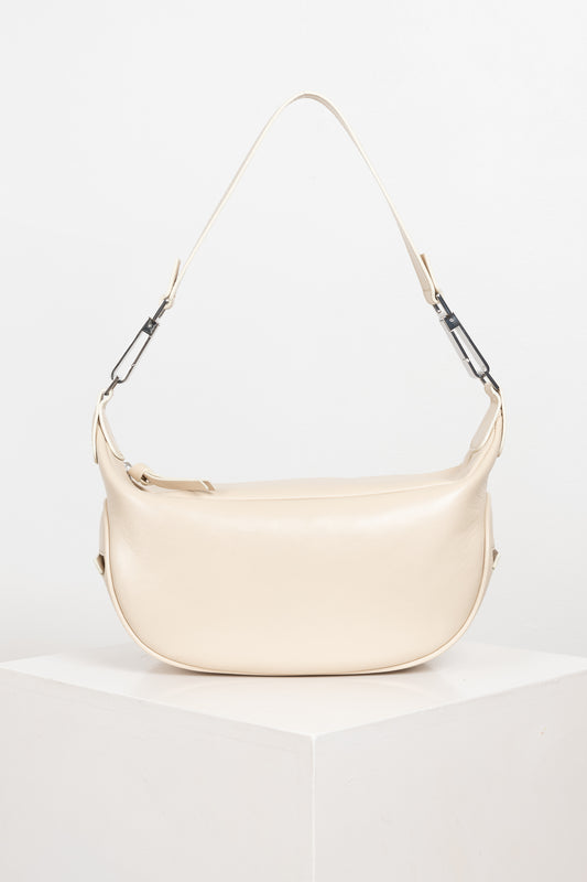The Ami Bag by BY FAR is a 2000's inspired soft bag with a slouchy silhouette and smooth edges