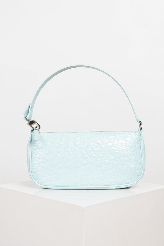 The Rachel bag by BY FAR is a 90's inspired iconic rectangular baguette style bag in Ice Blue crocs embossed leather