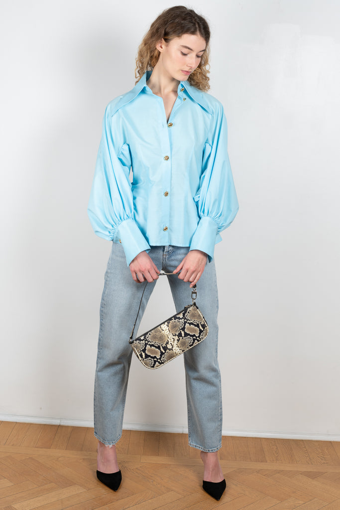 The Pointy Collar Blouse by Elzinga is a fitted shirt cut from a crisp cotton poplin with  voluminous puffed sleeves and beautiful golden buttons