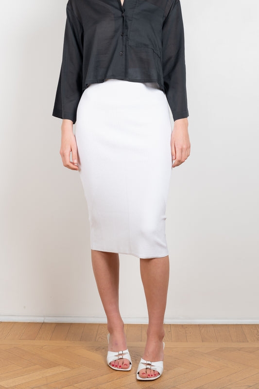 The Telde Skirt by Gauge81 is a reimagined high waist pencil skirt with a ribbed pattern and below the knee length in a soft viscose blend