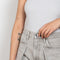 The Pleat Curve Jeans by Goldsign is a high waisted balloon shaped jeans with a front pleat in a light grey