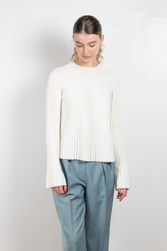 The Hairan Top by Loulou Studio is a ribbed A-line top with wide long bell sleeves in cream