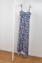 The jersey dress by Paco Rabanne is a midi length fine jersey dress in a small flower print with a asymmetric twist detail