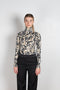 The turtleneck top by Paco Rabanne is a structured jacquard top in a black, gold and cream print