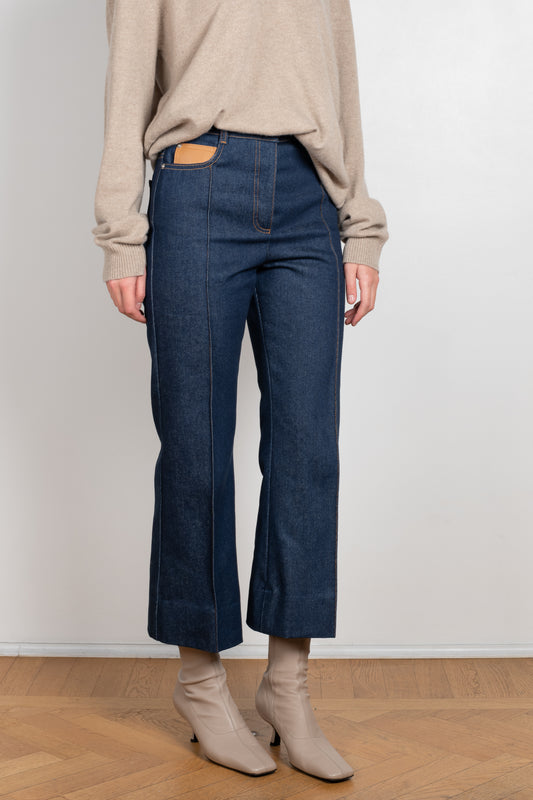 The Jeans Droit by Paco Rabanne is a high waisted cropped kickflare jeans in a raw blue wash