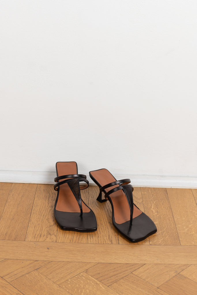 The Allie Sandals by Rejina Pyo are strappy t-bar thong sandals with a uniquely crafted sole