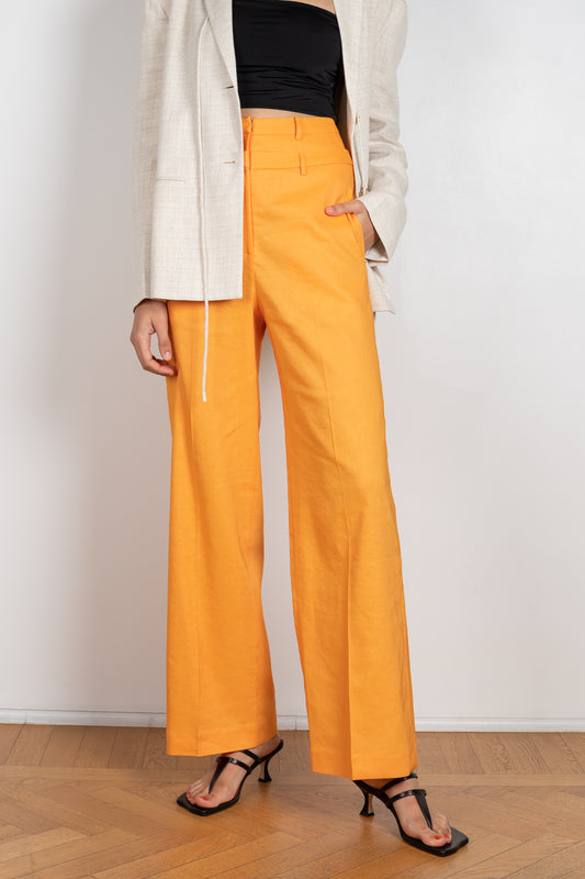 The Laila Trousers by Rejina Pyo are high waisted wide legged trousers with a custom double belt detail
