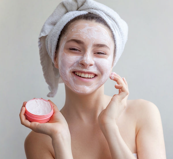 woman with face mask on smiling