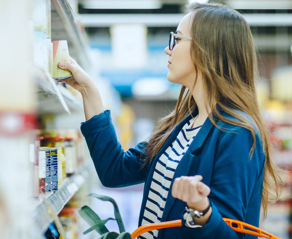 woman in supermarket checking for latex products