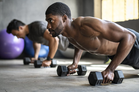 Men working out muscles in the gym