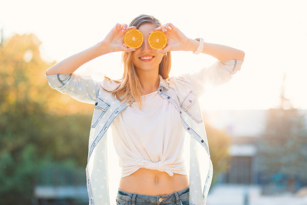 woman with vitamin C rich oranges