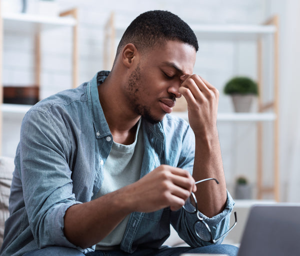 Man with fatigue sitting at his laptop