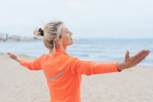 woman breathing in and taking in her surroundings to counter stress