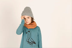 "LÖTIEKIDS Whale blue organic cotton tee-shirt with ""fly far"" illustration and corduroy detail at neck. ORGANIC"