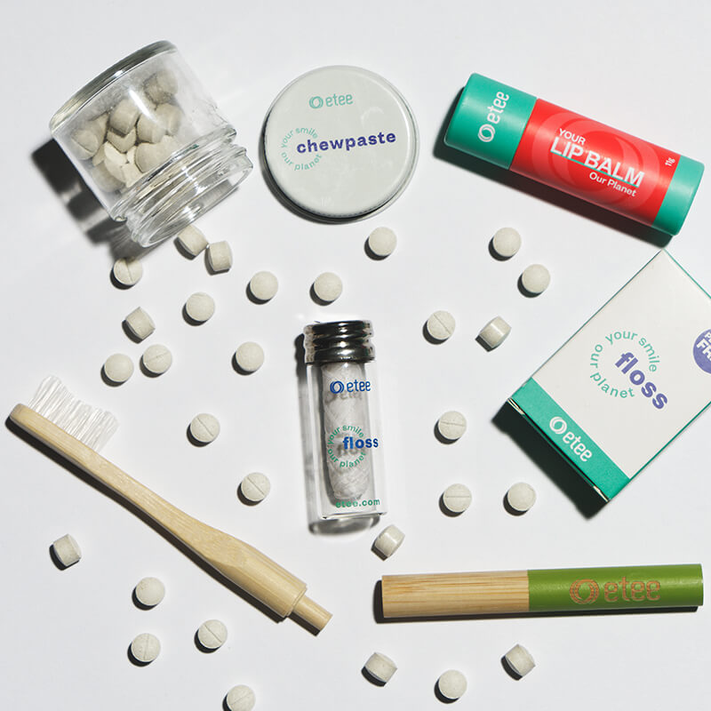dental products and toothbrush with green highlight