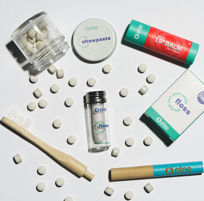 dental products and toothbrush with teal highlight