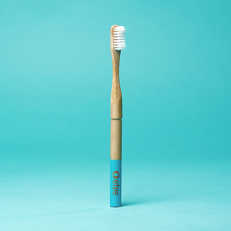 bamboo toothrbush with teal highlight