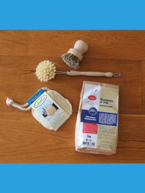 plastic free cleaning starter kit. Bicarbonate soda, natural brushes and loofa