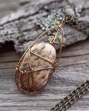 earthy wire wrapped michigan beach stone necklace antique brass metals