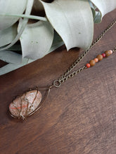 polished beach stone necklace antique brass chain