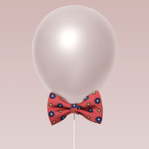 Little butterfly bow tie aster print coral and navy balloon
