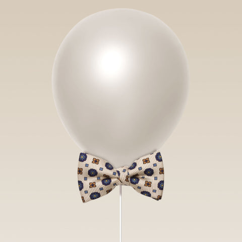 Little butterfly bow tie aster print cream and navy balloon