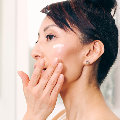 Fumiko Takatsu applying cream on her face.