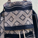 Black and camel multipocket backpack hand woven ethically in Oaxaca
