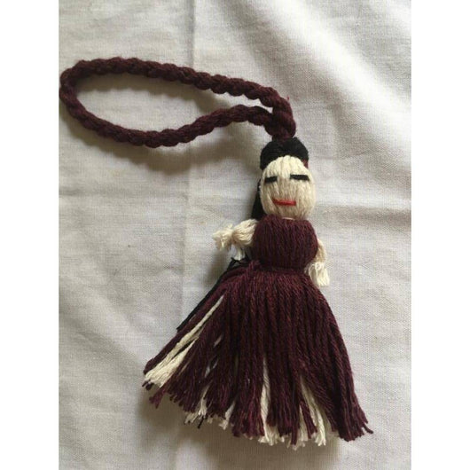 Burgundy zipper pulls and key holders crafted in Oaxaca