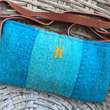 Small turquoise wool crossbag with thin leather strap made in Oaxaca ethically