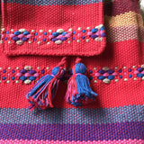Colorful red minibackpack and coin pouch handmade in Oaxaca Mexico ethically