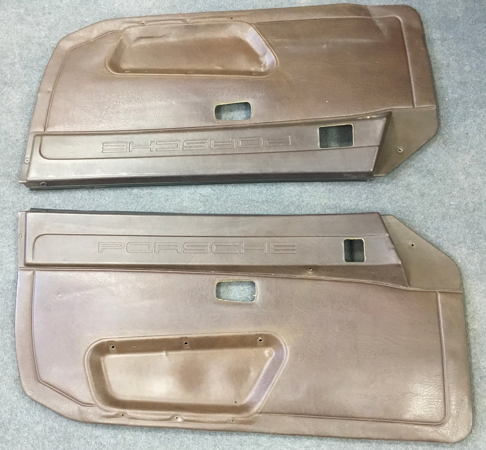 Porsche 944/924 brown logo door cards early type no speaker holes. - Porsche Spares UK Ltd