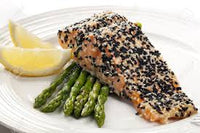 Organic Farmed Sesame Crusted Salmon  nested in Asparagus and Brocoli Rabe Swimming in Our Lemon Cashew Broccoli Rabe Infused Cream Sauce