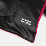 Red Poster Pocket Backpack by Raf Simons x Eastpak
