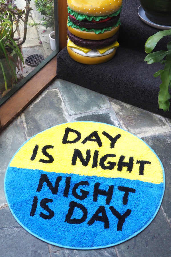 Day is Night / Night is Day Shaggy Door Mat - Third Drawer Down X David Shrigley