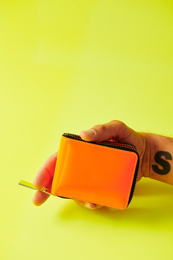 COMME DES GARÇONS SUPER FLUO LIGHT ORANGE MEDIUM ZIP WALLET
