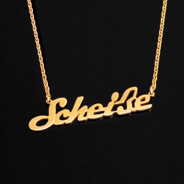 Scheiße by Schamoni Necklace by Jonathan Johnson