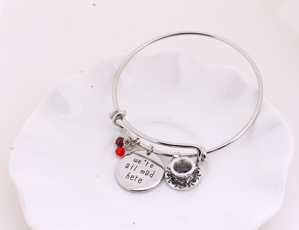 "Engraved ""We're All Mad Here"" and miniature cup plate Bangle Bracelet"