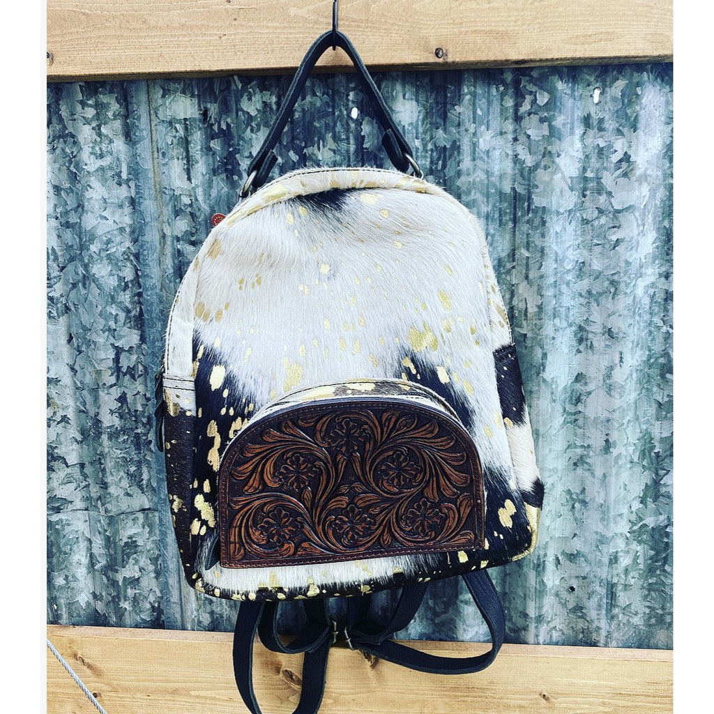 Hair On Hide Backpack - tooled leather pocket