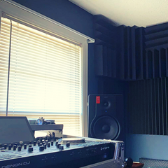 acoustic treatment behind speakers to reduce acoustic distortion 1