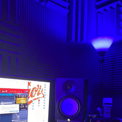 acoustic treatment behind speakers to reduce acoustic distortion