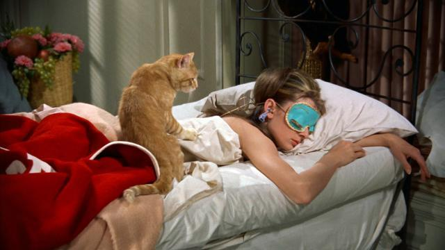 Hepburn with eye-mask stills