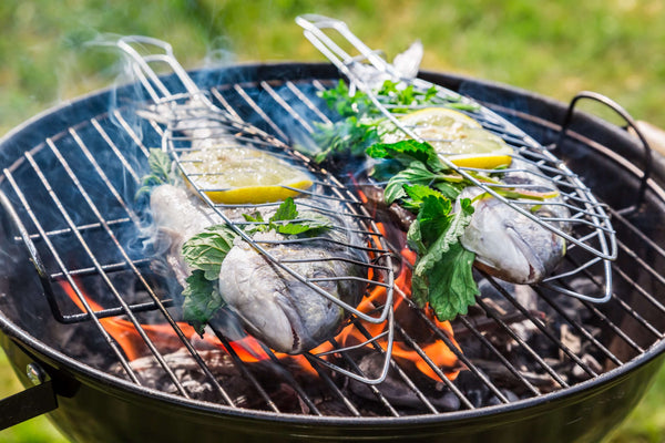 fish with lemon and herbs on the grill